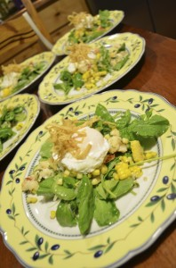Lobster & sweet corn over arugula with farm-fresh poached egg